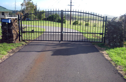 double swinging wrought iron security gate protecting a residential driveway in Morganton NC